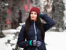 Beautiful young girl enjoy in winter park. Portrait of a cute brunette in a frosty park Royalty Free Stock Photos