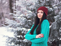 Beautiful young girl enjoy in winter park. Portrait of a cute brunette in a frosty park Stock Photo