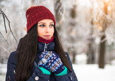 Beautiful young girl enjoy in winter park. Portrait of a cute brunette in a frosty park Stock Photography