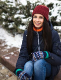 Beautiful young girl enjoy in winter park. Portrait of a cute brunette in a frosty park Royalty Free Stock Photo