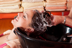 Beautiful young girl enjoying hair washing Royalty Free Stock Photo