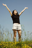 Beautiful young girl enjoying sunshine Stock Images