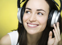 Beautiful young girl enjoys listening to music Royalty Free Stock Images