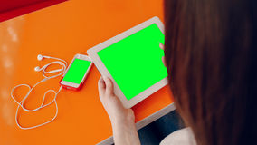 Beautiful young girl enjoys phone and tablet Stock Photo
