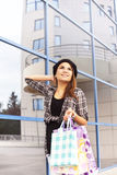 Beautiful young girl enjoys shopping Stock Photo