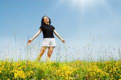 Beautiful young girl enjoys sunshine Royalty Free Stock Photography