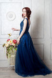 Beautiful young girl in evening dress posing at interior photo s stock photography