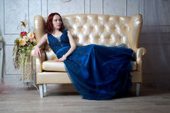 Beautiful young girl in evening dress posing at interior photo s Royalty Free Stock Images