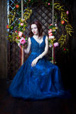 Beautiful young girl in evening dress posing at interior photo s Royalty Free Stock Image