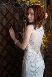 Beautiful young girl in evening dress posing at interior photo s Stock Photos