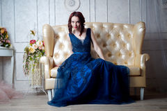 Beautiful young girl in evening dress posing at interior photo s Royalty Free Stock Photos