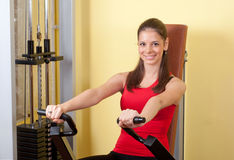 Beautiful young girl exercising in the gym Stock Photo