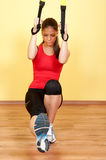Beautiful young girl exercising in the gym Stock Image