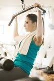 Beautiful young girl exercising at gym Stock Photo