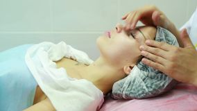 Beautiful young girl on a facial massage stock video footage