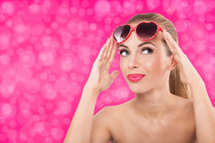 Beautiful young girl with fancy sunglasses Stock Images