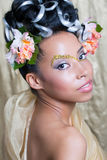 Beautiful young girl with fantasy makeup. Portrait of a beautiful young girl with curly hairstyle and fantasy makeup Royalty Free Stock Photo