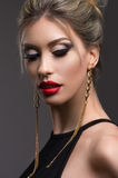 Beautiful young girl with fashion makeup Stock Image