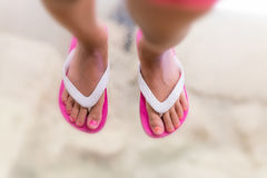 Beautiful young girl feet on a glass pavement.  Royalty Free Stock Photos