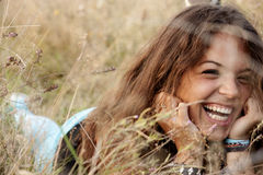 Beautiful young girl in a field Stock Images