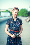 Beautiful young girl in fifties style with braces winking. Outdoor Royalty Free Stock Photography
