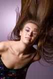 Beautiful young girl flipping her long hair Stock Photo