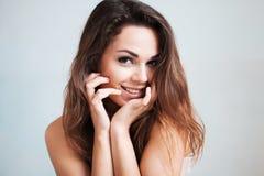 The beautiful young girl flirts stock photo