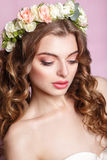 Beautiful young girl with a floral ornament in her hair.Beautiful Woman Touching her Face. Youth and Skin Care Concept.Nymph. Stock Photo