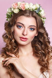 Beautiful young girl with a floral ornament in her hair.Beautiful Woman Touching her Face. Youth and Skin Care Concept.Nymph. Stock Photography