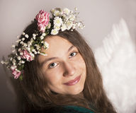 The beautiful young girl with flower Stock Photography