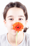 Girl with flower. Beautiful young girl with flower on white background Royalty Free Stock Images