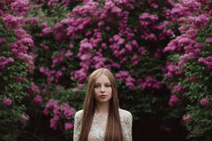 Beautiful young girl in a flowering lilac. Garden of lilac bloom Stock Photos