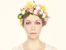 Beautiful young girl with flowers Stock Images