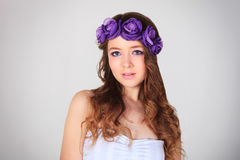 Beautiful young girl. With flowers royalty free stock photography