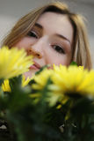 Beautiful young girl with flowers Stock Image