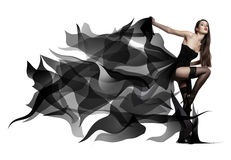 Beautiful young girl in flying black dress. Flowing fabric Royalty Free Stock Photo