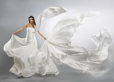 Beautiful young girl in flying white dress. Royalty Free Stock Photos