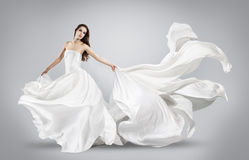 Beautiful young girl in flying white dress. Stock Image