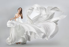 Beautiful young girl in flying white dress. Stock Images