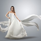 Beautiful young girl in flying white dress. Stock Photo