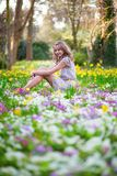 Beautiful young girl in forest on a spring day Stock Photo