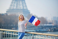 Beautiful young girl with French national flag Royalty Free Stock Photo