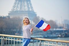 Beautiful young girl with French national flag Stock Images