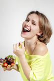 The beautiful young girl with fruit salad Royalty Free Stock Photography