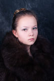 Beautiful young girl in fur Stock Photography