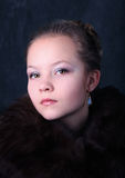 Beautiful young girl in fur stock image