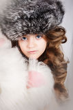 Beautiful young girl in fur cap Royalty Free Stock Image