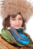 Beautiful young girl in a fur cap and with a scarf Royalty Free Stock Photos