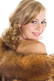 Beautiful young girl in a fur coat Royalty Free Stock Images