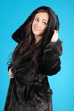 Beautiful young girl in fur coat Stock Photo